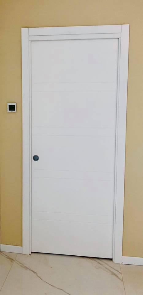 Porta scorrevole laccata bianca | Falegnameria F.lli Schiorlin